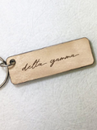 Image for the Delta Gamma Script Wooden Keychain product