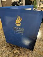 Image for the EGCC Blue Imprinted Folder with Torch product